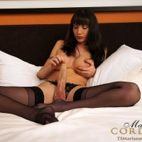 Leggy brunette tranny Mariana Cordoba jerking off hung dick in nylons