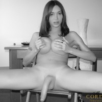 Older black and white pics of TS Mariana coaxing cumshot from massive cock