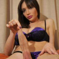 Black-haired solo T-girl Mariana Cordoba jerking off humungous prick in leather boots