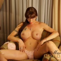 Buxom brown-haired shemale Mariana Cordoba opening up lengthy pins before tugging