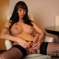 Dark-haired trans model Mariana Cordoba tugging monster rod in fishnet nylons