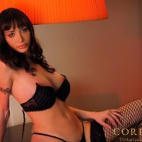 Huge-boobed dark haired Latina transgirl Mariana Cordoba unleashing large sausage from undies