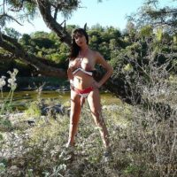 Leggy dark haired Tgirl Mariana Cordoba extracting massive meat stick from underwear in woods