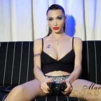 Tgirl gamer girl Mariana Cordoba having her monstrous pecker blown by bf