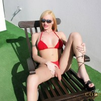 Blonde transsexual Mariana Cordoba licking own nipples outdoors in sunglasses