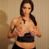 Hung TS pornstar Mariana Cordoba jacking off in fishnet stockings and heels