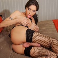 Hung TS pornstar Mariana Cordoba jacking off in fishnet stockings and heels