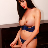 Gorgeous shemale Mariana Cordoba sets her nice tits and huge cock free of lingerie