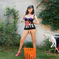 Busty and incredibly hung transsexual Mariana Cordoba takes care of her laundry