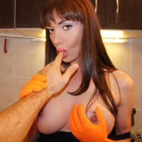 Beautiful trans female Mariana Cordoba gets a blowjob from a man while in the kitchen