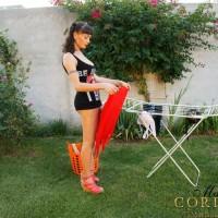 Mariana Cordoba grabs a large breast while jacking her massive dick in the backyard