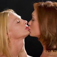 Mariana Cordoba ass fucks a blonde T-girl while they both wear heels on a sofa