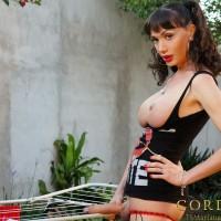 TS pornstar Mariana Cordoba letting her monster sized shedick hang loose outdoors