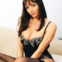 Sexy shemale Mariana Cordoba posing in black nylons while jacking huge cock
