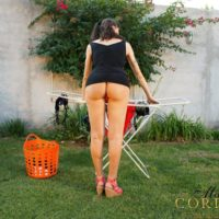 Bosomy brown-haired Tgirl Mariana Cordoba flaunting bare ass & vast cock outdoors