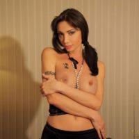 Dark-haired Latina transgirl Mariana Cordoba jackingher  she-dick in mesh stockings