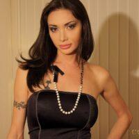 Brunette Latina TS Mariana Cordoba drains her hung tranny-dick in mesh pantyhose