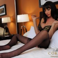 Big-chested brunette shemale Mariana Cordoba wanking off her monstrous wood in black pantyhose