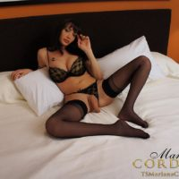 Busty dark-haired transgirl Mariana Cordoba tossing off monstrous meat-stick in ebony nylons