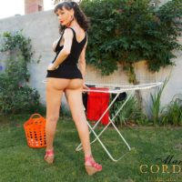 Busty trans babe Mariana Cordoba wanks her staggering penis in the backyard