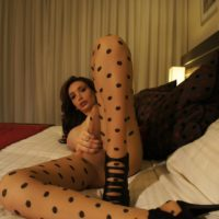 Callous dark haired tranny Mariana Cordoba stroking off in crotchless nylons