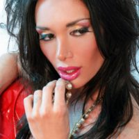 Dark-haired TRANSSEXUAL model Mariana Cordoba revealing big hooters and monster-sized hard-on