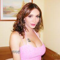 Fishnet stocking wearing shemale Mariana Cordoba unveiling her big shemale tits