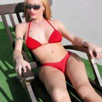 Inked T-girl Mariana Cordoba baring giant rack & monstrous pecker from bikini