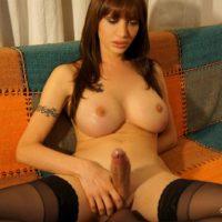 Naked transgirl Mariana Cordoba wanks off while watching hardcore porn flicks
