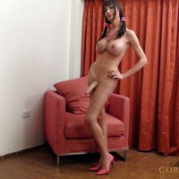 Naughty Transsexual Mariana Cordoba stripping on the davenport