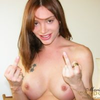 Nude tranny Mariana Cordoba rams a finger in her starfish while bent over