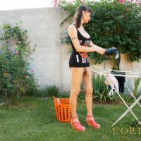 Skinny trans girl Mariana Cordoba exhibiting humungous dick outdoors in back yard