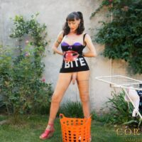 Solo T-girl Mariana Cordoba lets her monster phallus dangle free out in the backyard