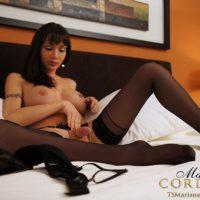Stocking garbed dark haired shemale Mariana Cordoba masturbating gigantic meat stick
